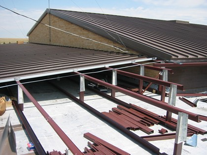 Planning Reroof Projects Using Retrofit Metal Roof Framing Systems