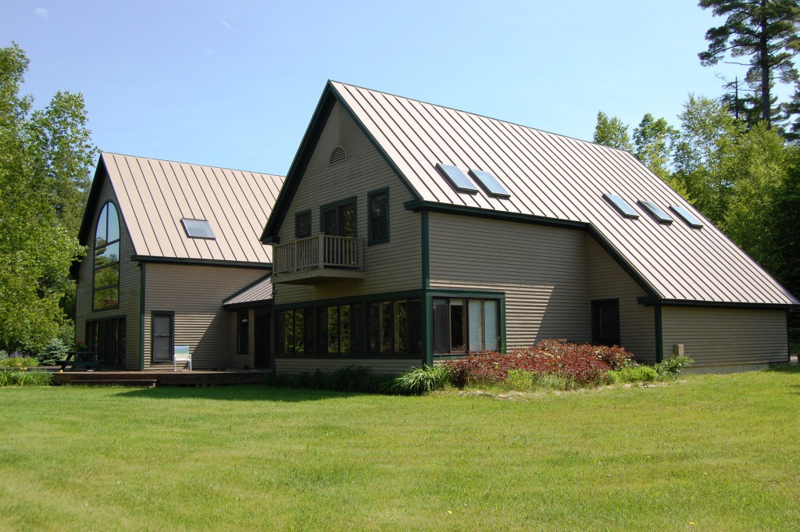 Englert metal roofing plays well on 39 golden pond 39 for Images of houses with metal roofs