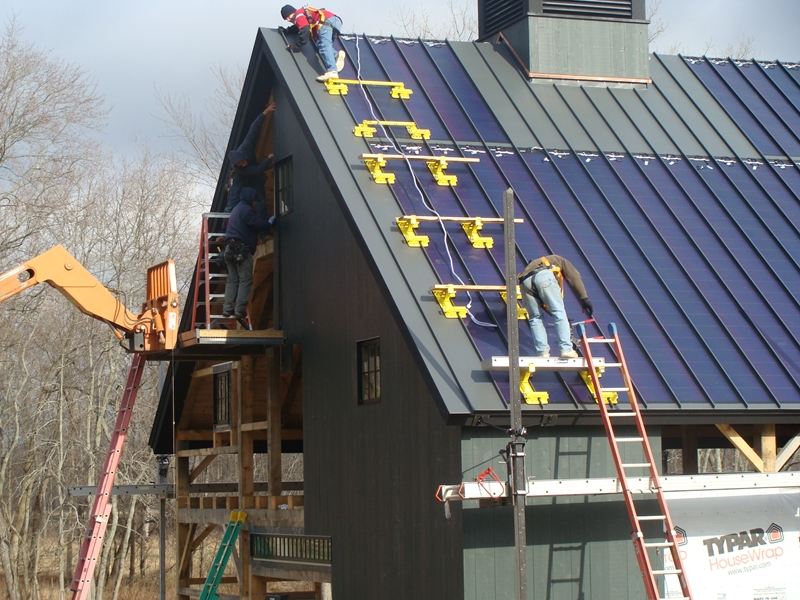 a solar collecting metal roof is shown during installation with the aid of roof brackets by metal plus llc click image to enlarge - Roof Brackets