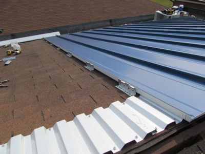 Mcelroy metal offers standing seam system to cover asphalt shingles - Put bitumen shingles roof cover ...