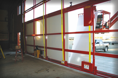 The electrical room showcases Schweiss\u0027 hydraulic and bifold doors and the company\u0027s new door liner/insulation offering. & Schweiss Doors Adds 20000 Square Feet Of Factory Space